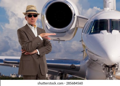 Handsome man next to private jet