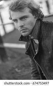 Handsome man with nice eyes in leather jacket