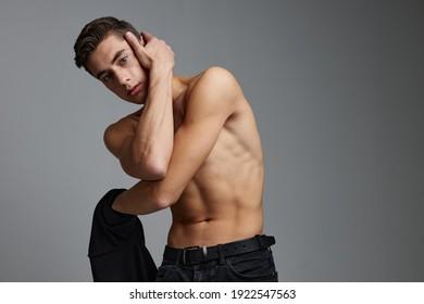 Handsome man nude torso black jacket posing self confidence lifestyle charm