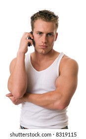 A handsome man on a cell phone looking at you