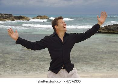Handsome man on tropical beach