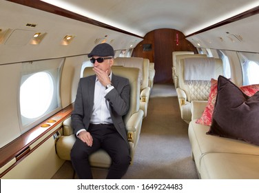 Handsome man on-board a private jet.