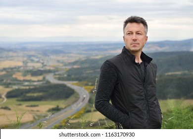 Handsome man. Outdoor male portrait over nature landscape in Navarre, Spain.