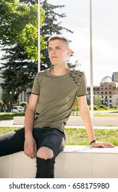 Handsome man outdoors portrait. Teenager looking in the camera