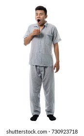 Handsome man in pajamas close up portrait studio on white background