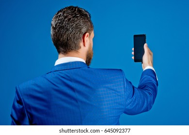 handsome man with phone in hand, new technology and communication, business fashion