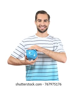 Handsome man with piggy bank on white background