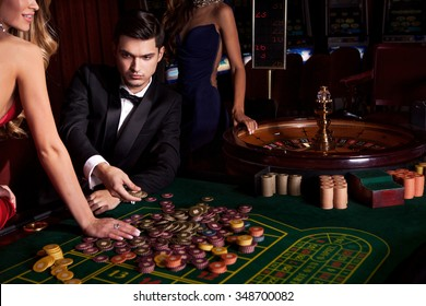 Handsome man playing in casino