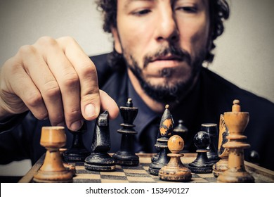 handsome man playing chess