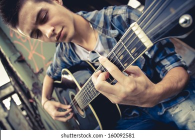 Handsome man playing guitar