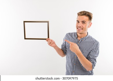 Handsome man points to the picture frame