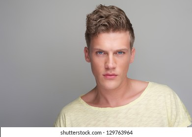 Handsome man portrait against gray background