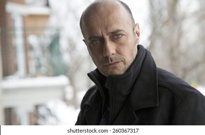 handsome man portrait taken outside at winter