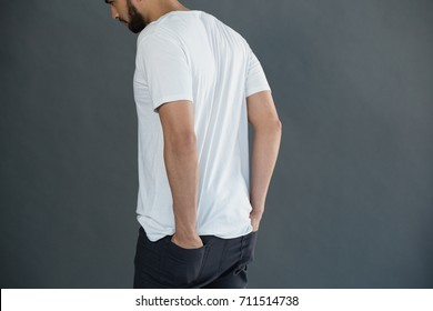 Handsome of man posing against grey background