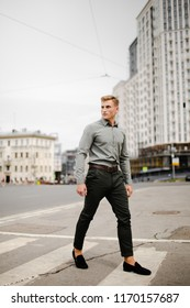 Handsome man posing in the city for clothes shooting