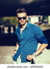 Handsome man posing on the street. fashion model male
