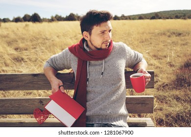 Handsome man reading a book in his holidays
