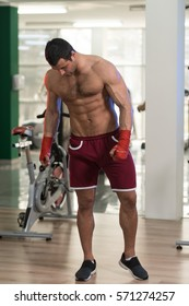 Handsome Man In Red Boxing Gloves - Boxing In Gym - The Concept Of A Healthy Lifestyle - The Idea For The Film About Boxing