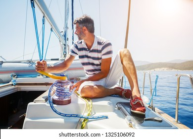 Handsome man resting On big Yacht in Greece