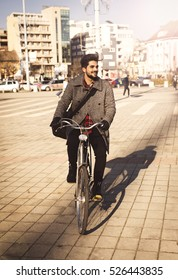 Handsome man rides his bike and goes to work.
