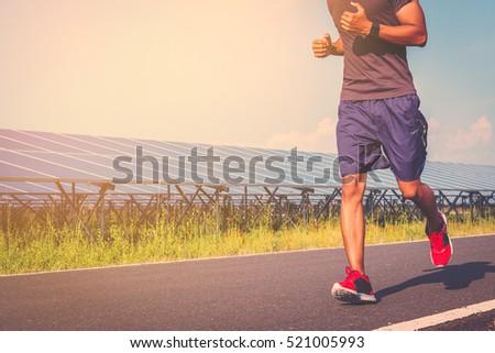 Handsome Man Running On Road S...