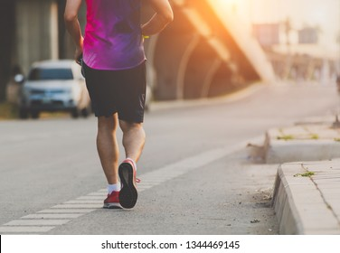 Handsome man running on road,The man with runner on the street be running for exercise, Health activities.