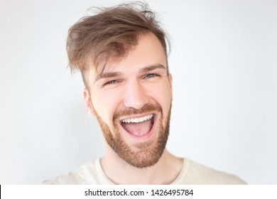 Handsome man screaming with pleasure