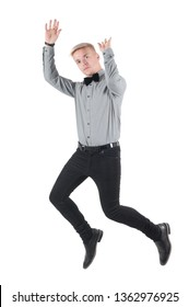 Handsome man in shirt and bow-tie jumping, isolated