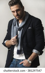 Handsome man in shirt,jacket,scarf,jeans