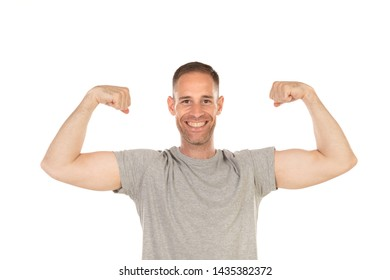 Handsome man showing his bicep isolated on a white background