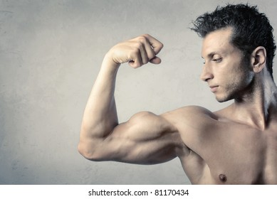 Handsome man showing his biceps