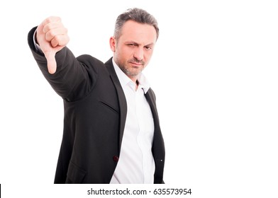 Handsome man showing thumbs down sign or dislike on white background with copyspace
