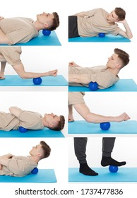 Handsome man shows exercises using the ball with spikes for a myofascial release massage of trigger points. Massage of the spine muscle. Isolated on white.