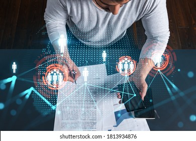 Handsome man sign SMM contract to promote personal brand project. Multiexposure. Social network hologram.