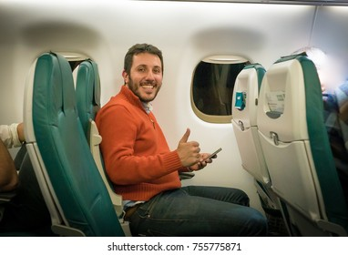 handsome man sit on the airplane ready for the flight