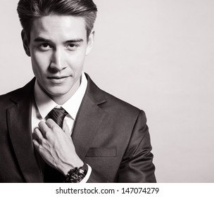Handsome man smiling (black and white portrait)