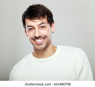 handsome man smiling to the camera, portrait of young man