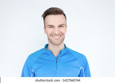 Handsome man in sportswear is looking at the camera and smiling