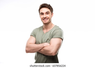 handsome man standing with crossed arms and looking at camera isolated on white