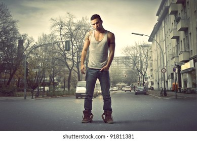 Handsome man standing on a city street