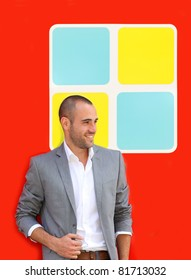 Handsome man standing on colorful wall