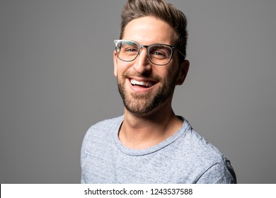 A Handsome man standing over dark grey background Portrait man concept.