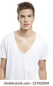 Handsome man standing with white t-shirt close up portrait on white background.