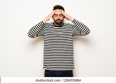 handsome man with striped shirt unhappy and frustrated with something