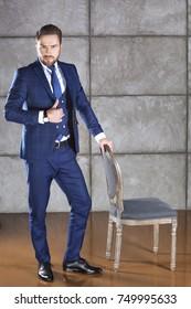 Handsome man in suit full-length portrait