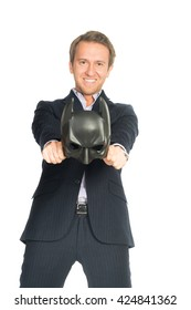 handsome man in suit wearing a batman mask isolated