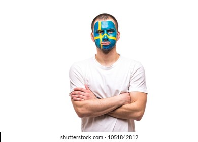 Handsome man supporter loyal fan of Sweden national team with painted flag face isolated on white.