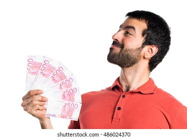 Handsome man taking a lot of money