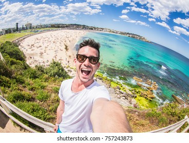 Handsome man taking a selfie on vacation