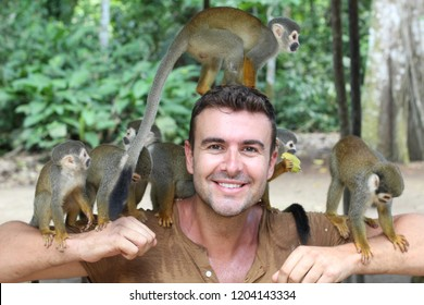 Handsome man with titi monkey's group